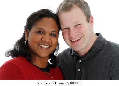 Husband and wife posing on white background