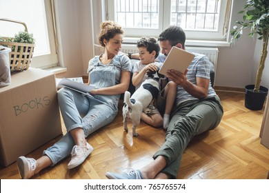 Husband and wife and their son and a pet moving in new home.