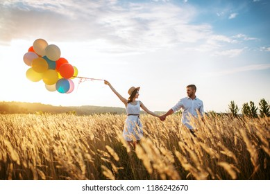 Husband and wife walks with bunch of balloons