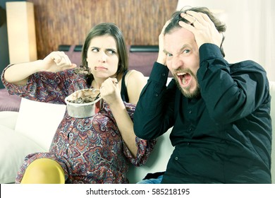 husband worried because his beautiful pregnant wife does not stop over eating
