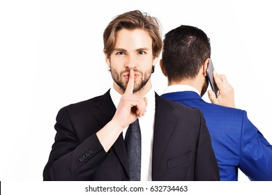 hush gesture, diversion and sabotage, corruption, man with hush gesture, busy businessman speaking on phone in formal suit isolated on white background