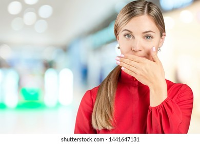 Hush. Woman asking for silence or secrecy with finger on lips shh hand gesture