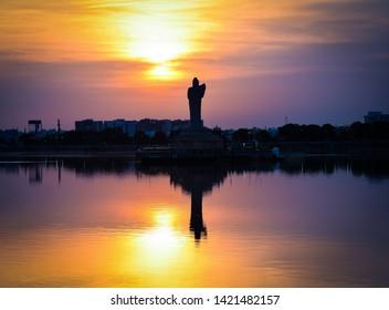 Hussain sagar and tank bund in hyderabad with Buddha statue