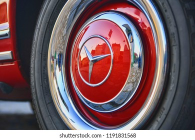 HUSTOPECE, CZECH REPUBLIC - SEPTEMBER 29, 2018: Mercedes Benz logo on vintage car wheel. Mercedes-Benz is a German automobile manufacturer. The brand is used for luxury automobiles, buses, coaches and