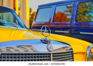 HUSTOPECE, CZECH REPUBLIC - SEPTEMBER 29, 2018: Mercedes Benz logo on a yellow vintage car. Mercedes-Benz is a German automobile manufacturer. The brand is used for luxury automobiles, buses, coaches