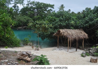 Hut by the blue lake on Vanuatu