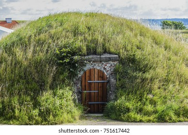 A hut in the ground under the grass in Denmark.