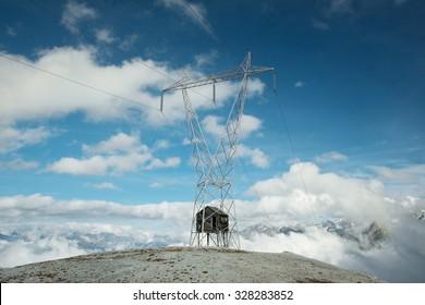 The hut inside the electricity power line, Stelvio pass, Italian Alps