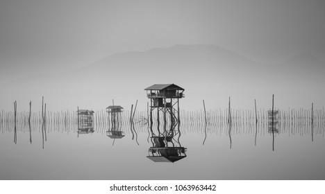 hut in the lake in sepia mode