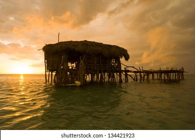 Hut made of wood on a sand bar in the Caribbean