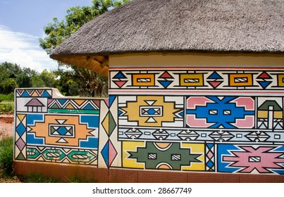 a hut showing the  traditional way in which the Ndebele tribe of South Africa paint their houses