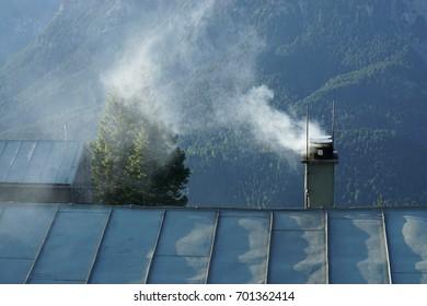 hut with smoking fireplace