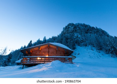 Hut in snowy landscape at sunrise, Tirol, Austria