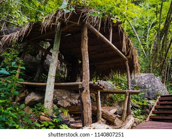 Hut and stairway in  forest