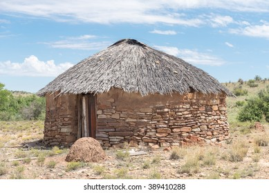 A hut with thatched roof built from stone next to the road between Steynsburg and Hofmeyer in the Eastern Cape Province of South Africa
