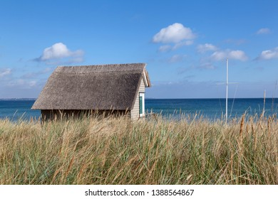 Hut with thatched roof on the beach of Scharbeutz in Schleswig-Holstein, Germany