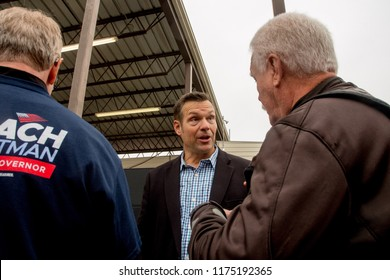 Hutchinson Kansas, USA, September 8, 2018Current Secretary of State Republican Kris Kobach at the conclusion of the debate talks with supporter about immigration issues regrading H-2A visas.