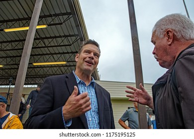 Hutchinson Kansas, USA, September 8, 2018Current Secretary of State Republican Kris Kobach talks with a supporter about immigration issues regrading H-2A visas