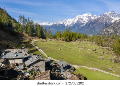 Huts in a mountain pasture in Valtellina
