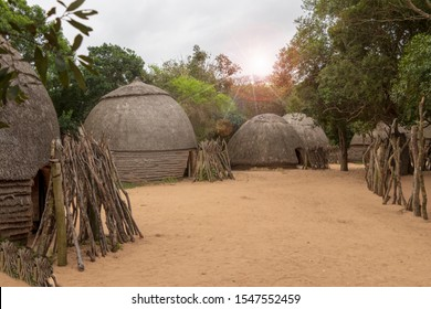 The huts of a Zulu village in the backlight in Kwazulu Natal in South Africa. The Zulu are a South African ethnic group and today live mainly in the province of Kwazulu Natal.