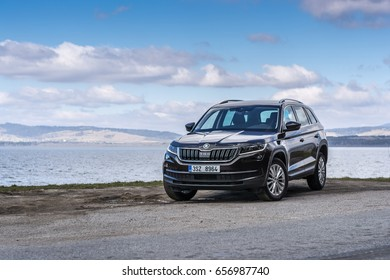 HUTY, THE SLOVAK REPUBLIC, 26. 3. 2017: Skoda Kodiaq 2.0 TDi Style, model year 2017 in Slovakia with view on mountains and lake