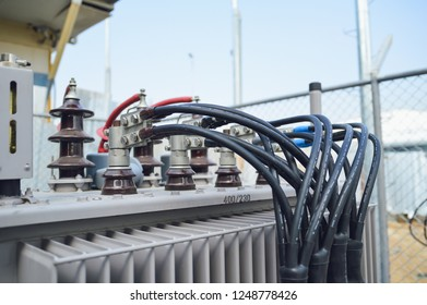 HV and LV Bushings of transformer with electrical insulation and electrical equipment in power substation.High voltage transformer.maintenance transformer, replace oil seal of bushing.