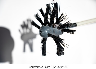 HVAC dryer vent cleaning brush isolated against a white background