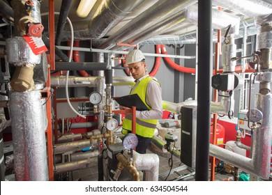 HVAC engineer in boiler room