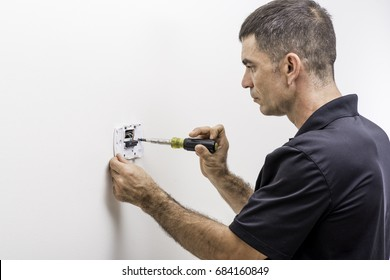 Hvac technician installing a digital thermostat