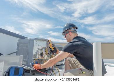 Hvac Technician servicing a rooftop condensing unit
