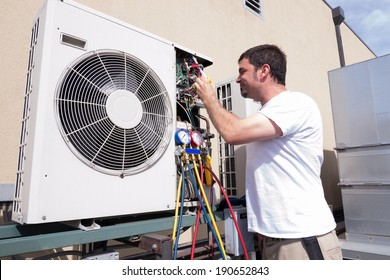 HVAC technician working on a mini-split condensing unit