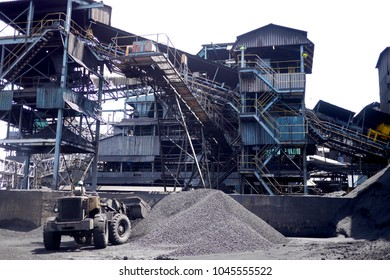 Hwange Colliery, Zimbabwe - 6 March 2016 : Large coal mine processing plant with grader moving coal.