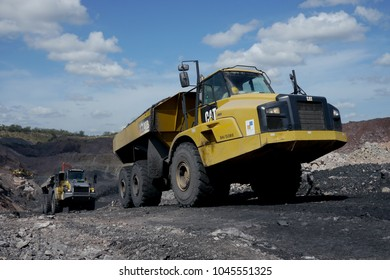 Hwange, Zimbabwe - 2 March 2016 : Large trucks excavate coal from an open cast mine.