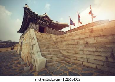 Hwaseong Fortress, a popular tourist destination Suwon South Korea atmospheric evening.