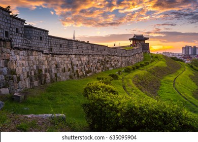 Hwaseong Fortress in Sunset, Traditional Architecture of Korea at Suwon and lawn in the park, South Korea.