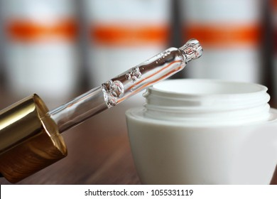Hyaluronic acid in a bottle with pipette, makeup