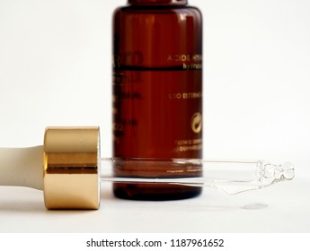 hyaluronic acid in brown glass bottle with golden cap and dropper close up