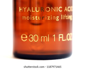 hyaluronic acid moisturizer in brown glass with pipette macro