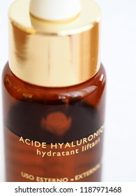 hyaluronic acid product brown bottle with golden letters