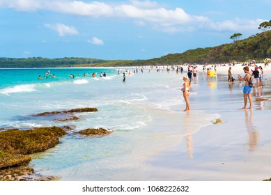 Hyams Beach, Australia-March 31, 2018: People enjoying the sunny weather at Hyams Beach with fine white sand, a charming seaside village in Shoalhaven region on the South Coast of NSW, Australia