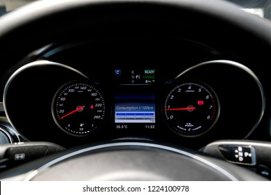 Hybrid car dashboard show consumption scale in monitor display.