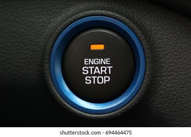 Hybrid car engine star-stop button, car interior