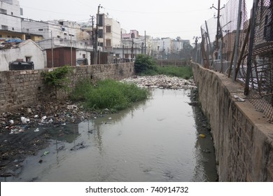 HYDERABAD, INDIA - 22 OCTOBER,2017.Sewage canal clogged by floating waste in Hyderabad,India