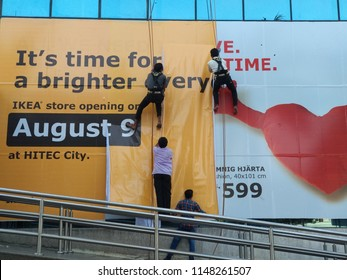 HYDERABAD, INDIA - August 03,2018 Workers putting up banners of Ikea at a multiplex in Hyderabad,India. Ikea will open its first store in India in southern city of Hyderabad on August 09,2019.