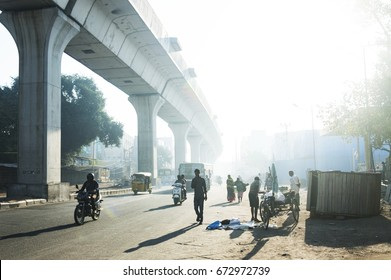 HYDERABAD, INDIA - DECEMBER 23, 2016: a pedestrian walking on the foggy road