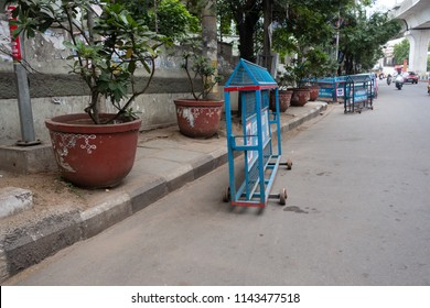 HYDERABAD, INDIA - Jul 27,2018 Potted plants and unauthorized curb parking forces pedestrians to walk on the street in Hyderabad,India