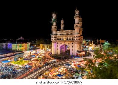 HYDERABAD, INDIA - June 17, 2017: Charminar with traffic movement around it on the night of eid-ul-fitr of ramadan month in Hyderabad, Telangana, India