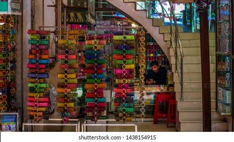Hyderabad, India - June 17, 2019 : Shopkeeper selling bangles, Laad Bazaar or Choodi Bazaar is a very old market popular for bangles located near Charminar.