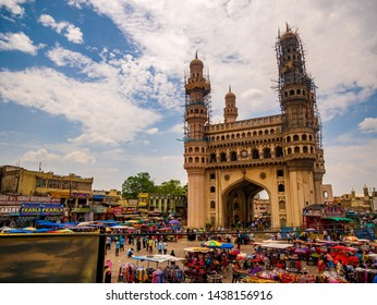Hyderabad, India - June 17, 2019 : The Charminar, panoramic view of the iconic monument and mosque & street shops around the place