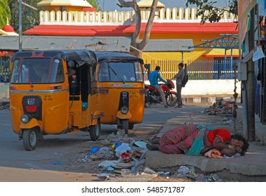 HYDERABAD, INDIA - MARCH 11, 2015: homeless woman is sleeping outdoor in Hyderabad, India